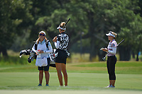 Nelly Korda (USA) chats with Brooke M. Henderson (CAN) and caddie near the green on 7 during round 1 of the 2019 US Women's Open, Charleston Country Club, Charleston, South Carolina,  USA. 5/30/2019.<br /> Picture: Golffile | Ken Murray<br /> <br /> All photo usage must carry mandatory copyright credit (© Golffile | Ken Murray)