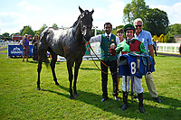 Connections of Nyaleti in the winners enclosure after winning The Toby Balding Memorial Novice Stakes (Plus 10), during Father's Day Racing at Salisbury Racecourse on 18th June 2017