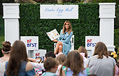 First Lady Melania Trump reads a book to children during the White House Easter Egg Roll at the White House in Washington, D.C. on April 22, 2019. <br /> Credit: Kevin Dietsch / Pool via CNP