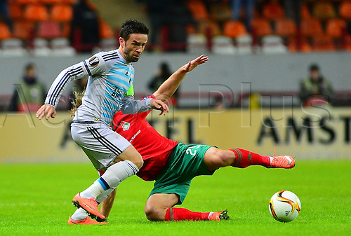 25.02.2016.  Moscow, Russia.  UEFA Europa league Last 32 second leg match between Lokomotiv Moscow and Fenerbahce at Lokomotiv Stadium in Moscow , Russia on February 25 , 2016. Gokhan Gonul of Fenerbahce and Vitali Denisov of Lokomotiv Moscow.