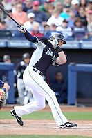 Michael Saunders #55 of the Seattle Mariners bats in a spring training game against the San Diego Padres at Peoria Stadium on February 27, 2011  in Peoria, Arizona. .Photo by:  Bill Mitchell/Four Seam Images.