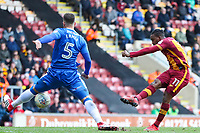Dom Poleon of Bradford City shoots and scores during the Sky Bet League 1 match between Bradford City and Gillingham at the Northern Commercial Stadium, Bradford, England on 24 March 2018. Photo by Thomas Gadd.