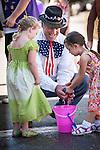 Independence Day celebration Main Street, Mokelumne Hill, California..Wet Sponge Race..Sam Garamendi