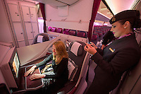 L'interno della Business Class del Boeing 787-8 Dreamliner della Qatar Airways in occasione del volo inaugurale della nuova rotta tra Roma e Doha, all'aeroporto internazionale di Roma Fiumicino, 30 marzo 2015.<br /> A view of the Business Class of the Qatar Airways' Boeing 787-8 Dreamliner on the occasion of the inaugural flight of the new route between Rome and Doha, at Rome's Fiumicino international airport, 30 March 2015.<br /> UPDATE IMAGES PRESS/Riccardo De Luca