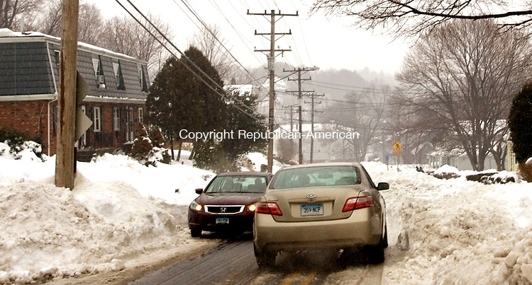 NAUGATUCK, CT. 11 February 2013-021113SV13-Many streets in the area like Cherry Street were only plowed to one lane making it hard for cars to pass in Naugatuck Monday..Steven Valenti Republican-American