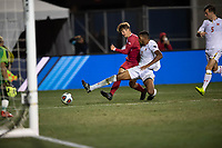 Santa Barbara, CA - Friday, December 7, 2018:  Maryland men's soccer defeated Indiana 2-0 in a semi-final match in the 2018 College Cup.  Maryland's Donovan Pines defends Indiana's Justin Rennicks.