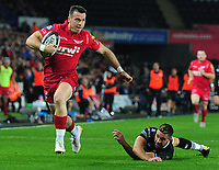 Scarlets' Gareth Davies evades the tackle of Ospreys' Rhys Webb<br /> <br /> Photographer Ashley Crowden/CameraSport<br /> <br /> Guinness Pro14 Round 6 - Ospreys v Scarlets - Saturday 7th October 2017 - Liberty Stadium - Swansea<br /> <br /> World Copyright &copy; 2017 CameraSport. All rights reserved. 43 Linden Ave. Countesthorpe. Leicester. England. LE8 5PG - Tel: +44 (0) 116 277 4147 - admin@camerasport.com - www.camerasport.com