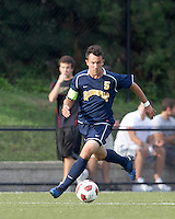 Quinnipiac University forward Durval Pereira (5) brings the ball forward. Boston College defeated Quinnipiac, 5-0, at Newton Soccer Field, September 1, 2011.