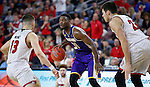 SIOUX FALLS, SD: MARCH 4: Garret Covington #31 of Western Illinois looks past South Dakota defenders Matt Mooney #13 and Tyler Flack #23 on March 4, 2017 during the Summit League Basketball Championship at the Denny Sanford Premier Center in Sioux Falls, SD. (Photo by Dick Carlson/Inertia)