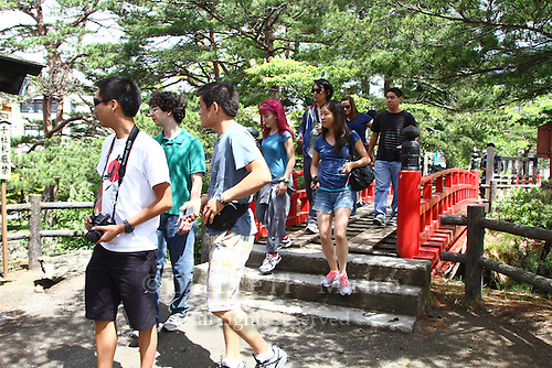 """June 20, 2012; Matsushima, Miyagi Pref., JPN - Tohoku recovery. ..Students on the Terasaki Foundation Japan Educational Tour in Matsushima...The Bishamondo (the shrine of a Buddhist god) was erected on the occasion of Sakanoueno Tamuramaro's (758-811 A.D.) expedition to the East, and the """"Godaido Hall"""", a symbol of Matsushima, was named after the Godai Myoo (the Five Great Vidyarajas) enshrined on the occasion of the establishment of the Zuiganji Temple by the Great Monk Jikaku (794-864 A.D.). The current building was reconstructed by lord Date Masamune, utilizing all possible methods of the Momoyama Architectural Style. According to the legend, when the Great Monk Jikaku enshrined the Five Great Vidyarajas, the Bishamonten (a god of Buddhism) dedicated by the Sakanoueno Tamuramaro, flew away to one of the offshore islands beaming lights. The island Bishamonten landed on is now called Bishamonto Island."""