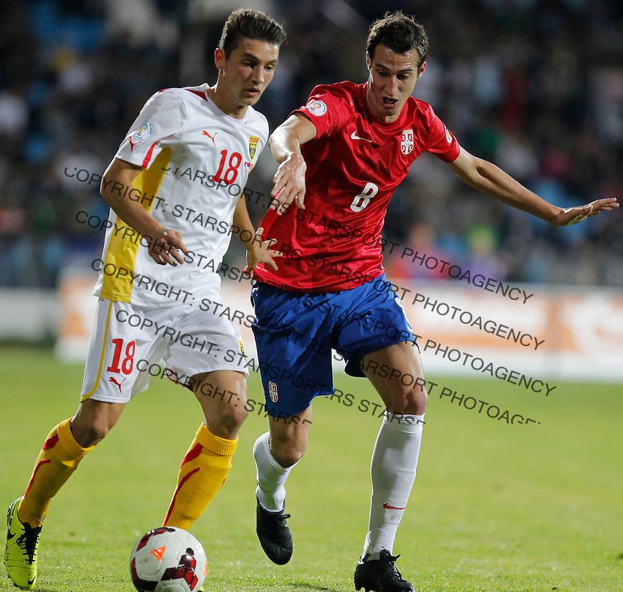 Fudbal Soccer<br /> World Cup 2014 qualifiers match<br /> Serbia v Macedonia<br /> David Babunski (L) and Radosav Petrovic<br /> Jagodina, 15.10.2013.<br /> foto: Srdjan Stevanovic/Starsportphoto &copy;