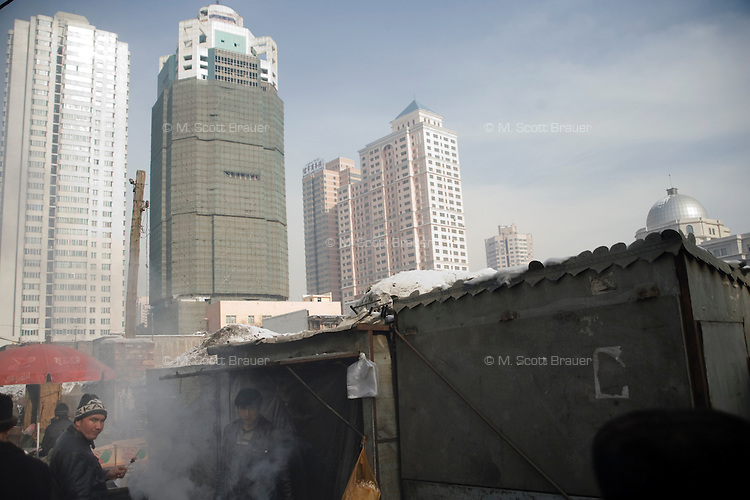 New high-rise buildings tower over the Uighur section of Urumqi, Xinjiang, China.