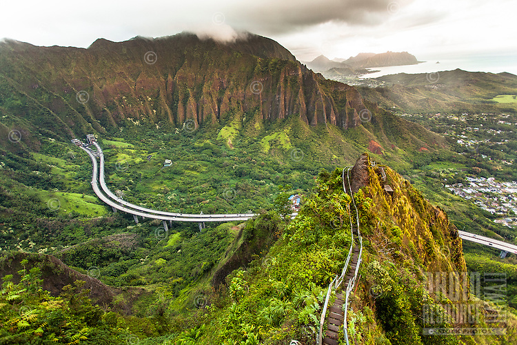 "An aerial view at dawn of the Ko'olau mountain range and H-3 Freeway in Haiku valley from the Haiku Stairs (""Stairway to Heaven"") hiking trail in Kaneohe, O'ahu"