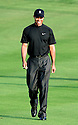 Tiger Woods (USA ) smiles as he walks to his ball during the 1st round of the Dubai Desert Classic, Emirates GC, Dubai, United Arab Emirates / 31 Jan - 03 Feb 2008. .Picture Credit / Phil Inglis
