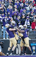 The Huskies celebrate Chico McClatcher's first quarter touchdown.