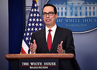 United States Secretary of the Treasury Steven Mnuchin talks about the new IRS withholding tables in the Brady Press Briefing Room of the White House in Washington, DC on Thursday, January 11, 2018.  Mnuchin said the new withholding tables will reflect the changes made by the GOP tax law, noting that 90 percent of wage earners will see greater take-home pay once they are implemented.<br /> CAP/MPI/RS<br /> &copy;RS/MPI/Capital Pictures