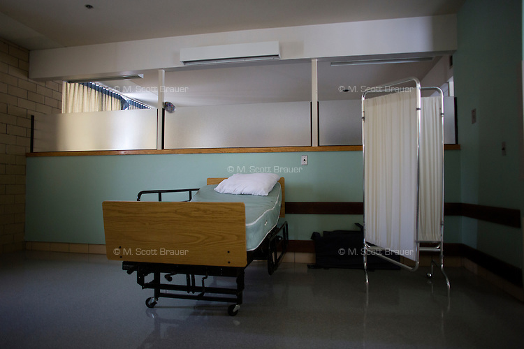 The living areas in the Green Building at the Fernald Developmental Center in Waltham, Massachusetts, USA, housed people with severe mental disabilities until 2011.  The open plan allowed caregivers to monitor and access residents easily.