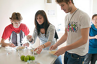 English as a Foreign Language students preparing a meal in the communal kitchen in the Halls of Residence , Further Education College.