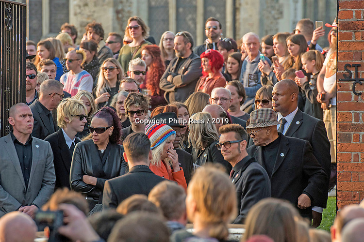 Mourners leaving the funeral of Prodigy singer Keith Flint at St Marys Church in Bocking,  Essex today.