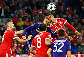 September 12th 2017, Munich, Germany, Champions League football, Bayern Munich versus Anderlecht;  Lukasz Teodorczyk forward of RSC Anderlecht and Corentin Tolisso of Bayern Munchen   challenge for the header during the match