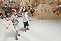 NWA Democrat-Gazette/FLIP PUTTHOFF <br /> Liam Anderson (left) and his training buddy, Joseph Rouse, encourage     Aug. 22 2019    climbers during practice.