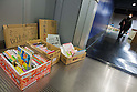 Saitama, Japan - A photo made available on March 22, 2011 shows a mini-library of books on the floor for the evacuees to use along the hallways at Saitama Super Arena, a temporary shelter in Saitama, north of Tokyo. Thousands of residents from Fukushima evacuated their town as high levels of radiation continued to be a high risk from the quake-hit nuclear plant. (Photo by Christopher Jue/Nippon News/AFLO)