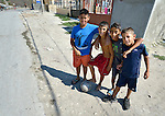 Children pose in the Maxsuda neighborhood of Varna, Bulgaria. Many Turkish-speaking Roma families live in this neighborhood.