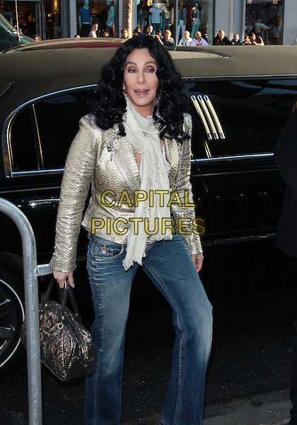 "CHER.""A Star Is Born"" World Premiere-Arrivals held at Grauman's Chinese Theatre, Hollywood, California, USA, .22nd April 2010..half 3/4 length jeans scarf gold jacket silver snakeskin snake cream white scarf bag denim .CAP/ADM/TC.©T. Conrad/AdMedia/Capital Pictures."