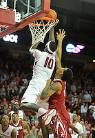 NWA Democrat-Gazette/Michael Woods --01/06/2015--w@NWAMICHAELW... University of Arkansas forward Bobby Portis goes up to tip the ball in over Alabama defender Shannon Hale to give the Razorbacks the lead as the clock runs out in overtime as the Razorbacks beats Alabama in Thursday nights game at Bud Walton Arena in Fayetteville.