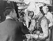 "Cape Canaveral, FL - (FILE) -- Astronaut Virgil I. ""Gus"" Grissom, left, wishes Alan B. Shepard, right, a safe flight just before insertion into the Freedom 7 spacecraft mated to the Redstone rocket before launch on Friday, May 5, 1961..Credit: NASA via CNP"