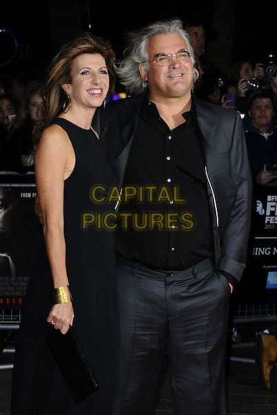 Joanna Kaye &amp; Paul Greengrass<br /> The opening film premiere of 'Captain Phillips', 57th BFI London Film Festival, Odeon Cinema, Leicester Square, London, England.<br /> 9th October 2013<br /> half length suit black dress grey gray glasses shirt black couple<br /> CAP/CAN<br /> &copy;Can Nguyen/Capital Pictures