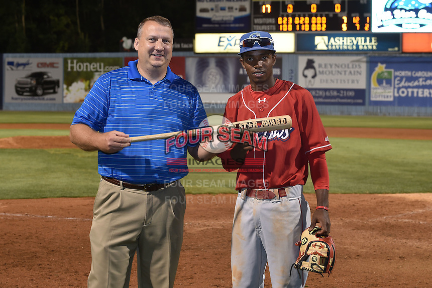South Atlantic League president Eric Krupa presents MVP award to Lakewood BlueClaws shortstop Malquin Canelo (33) after the South Atlantic League All Star Game on June 23, 2015 in Asheville, North Carolina. The North Division defeated the South 7-5(Tony Farlow/Four Seam Images)