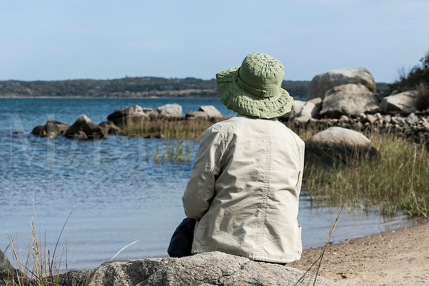 Senior woman enjoys a peaceful coastal view, Martha's Vineyard, Massachusetts, USA