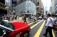 HONG KONG - MAY 06: Crowds of pedestrians and white-collars cross the street in Central business district, on May 6, in Hong Kong. (Photo by Lucas Schifres/Pictobank)