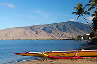 Outrigger canoe at Sugar Beach, Kihei, Maui, with the West Maui Mountains in the background.