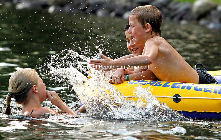 Goshen, CT- 28, June 2010-062810CM02 Harrison Porter, 9, of Goshen (right) and James Descault (left), 11, of Plymouth get into a splash war with Eliza Porter 12, of Goshen Monday afternoon at Woodridge Lake in Goshen.  The humidity is expected to let up today (Tuesday 6/29), with highs in the mid to upper 80's.  --Christopher Massa Republican-American