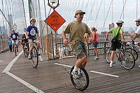 Brooklyn, NY -  3 September 2010 Unicyclists cross the Brooklyn Bridge, enroute to Coney Island, for the 13 mile Brooklyn Long Distance Unicycle Ride.
