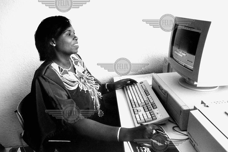 ©Giacomo Pirozzi/Panos Pictures..Rwanda. Female computer operator.