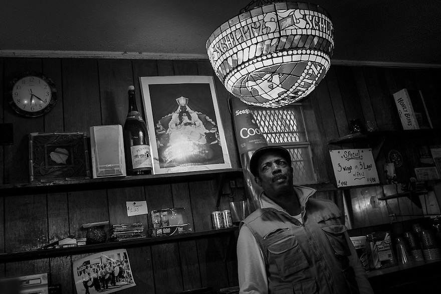 "Tyrone Roper owns the the D&F bar, (named after his parents Donald and Francis) one of the juke joints on Mosquito Beach in the Sol Legare community on James Island. The ""beach"" is a quarter-mile strip of marshland and mud, but back when segregation was still in effect, it was one of the few waterfront areas that welcomed African Americans. There was not much swimming to be had but they danced, drank and ate in the restaurants and juke joints."