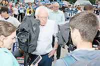 Democratic presidential candidate and Vermont senator Bernie Sanders speaks to the press before marching in the Labor Day Parade in Milford, New Hampshire, on Mon., September 2, 2019. Candidates Bernie Sanders and Vermin Supreme were the only candidates who marched in the parade this year.
