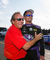 Sep 3, 2017; Clermont, IN, USA; NHRA funny car driver Jack Beckman (right) talks with team owner Don Schumacher during qualifying for the US Nationals at Lucas Oil Raceway. Mandatory Credit: Mark J. Rebilas-USA TODAY Sports