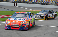 Jul. 3, 2008; Daytona Beach, FL, USA; NASCAR Sprint Cup Series driver Jeff Gordon (24) leads Mark Martin (8) as they head into the garage during practice for the Coke Zero 400 at Daytona International Speedway. Mandatory Credit: Mark J. Rebilas-