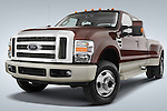 Low aggressive front three quarter view of a 2008 Ford F350 Crew Cab