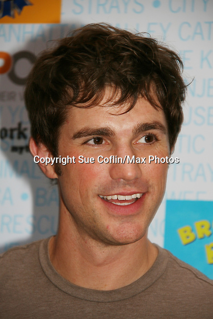 """As The World Turns' Matt Cavanaugh stars in Westside Story at Broadway Barks 11 - a """"Pawpular"""" star-studded dog and cat adopt-a-thon on July 11, 2009 in Shubert Alley, New York City, NY. (Photo by Sue Coflin/Max Photos)"""