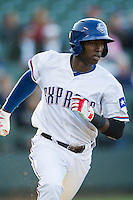Round Rock Express shortstop Jurickson Profar #10 runs to first base against the Omaha Storm Chasers in the Pacific Coast League baseball game on April 4, 2013 at the Dell Diamond in Round Rock, Texas. Round Rock defeated Omaha in their season opener 3-1. (Andrew Woolley/Four Seam Images).