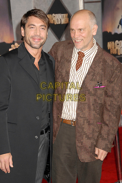 """JAVIER BARDEM & JOHN MALKOVICH.""""No Country For Old Men"""" Los Angeles Premiere at the El Capitan Theatre, Hollywood, California, USA, .4 November 2007..half length black jacket coat brown tie.CAP/ADM/BP.©Byron Purvis/AdMedia/Capital Pictures."""