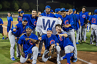 Yonathan Perlaza (15), Jose Gutierrez (91), Emilio Ferrebus (43), Carlos Sepulveda (16), Faustino Carrera (97), and Eugenio Palma (86) celebrate with the Cubs Win Flag after defeating the AZL Giants on September 7, 2017 at Scottsdale Stadium in Scottsdale, Arizona. AZL Cubs defeated the AZL Giants 13-3 to win the Arizona League Championship Series two games to one. (Zachary Lucy/Four Seam Images)