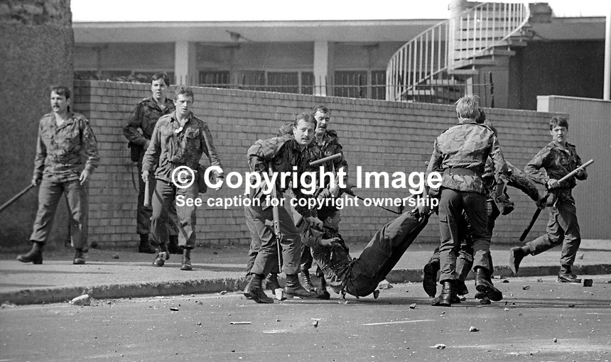 The Silver Jubilee visit of Queen Elizabeth II to N Ireland on 10th &amp; 11th August 1977 sparked serious rioting in Belfast as those opposed to the visit tried to reach the city centre. Soldiers drag an injured colleague to safety.  1977081000744k<br />