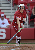 NWA Democrat-Gazette/ANDY SHUPE<br /> Arkansas right fielder Katie Warrick watches a ball sail to right field against Wichita State Wednesday, April 10, 2019, during the fourth inning at Bogle Park in Fayetteville. Visit nwadg.com/photos to see more photographs from the game.