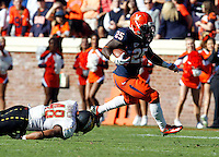 Virginia Cavaliers running back Kevin Parks (25) runs past Maryland Terrapins defensive back Eric Franklin (48) during the game in Charlottesville, Va. Maryland defeated Virginia 27-20.